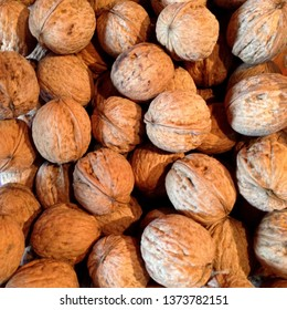 Macro Photo Product Nuts. Walnuts in the shell. Background of many round walnuts