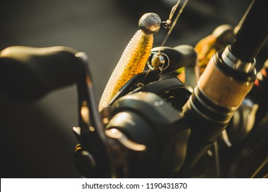 A macro photo of a rigged up baitcasting reel ready to catch a giant bass.