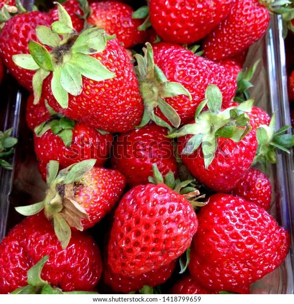 Macro Photo of strawberry berry food. Texture pattern background of ripe juicy red strawberries. Image berries fresh strawberries