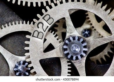 Macro photo of tooth wheel mechanism with B2B concept words