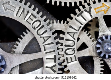 Macro photo of tooth wheel mechanism with arrows and INEQUALITY, EQUALITY concept a