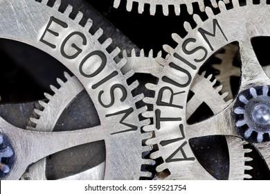 Macro photo of tooth wheel mechanism with imprinted EGOISM, ALTRUISM concept words