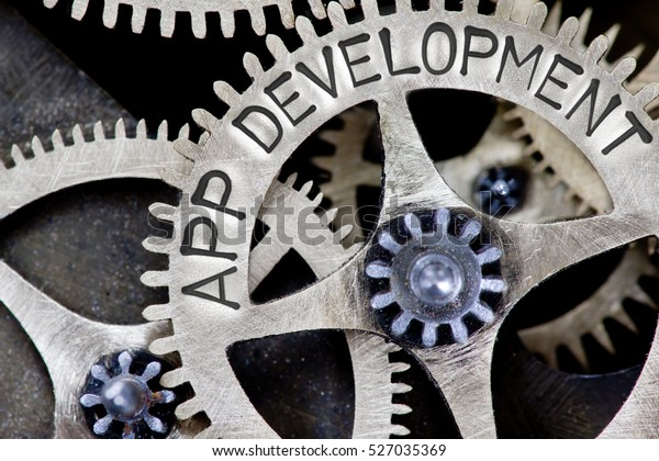 Macro photo of tooth wheel mechanism with APP DEVELOPMENT concept letters