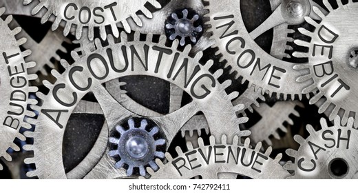 Macro photo of tooth wheels with ACCOUNTING, INCOME, DEBIT, CASH, COST, REVENUE and BUDGET words imprinted on metal surface