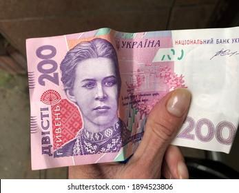 Macro photo Ukraine money bill. Stock photo Ukrainian hryvnia in hand