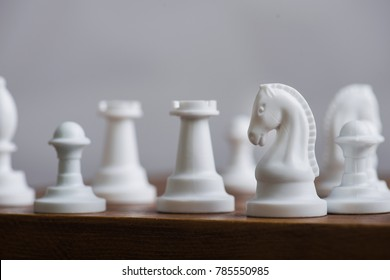 Macro photo of white chess horse figure
