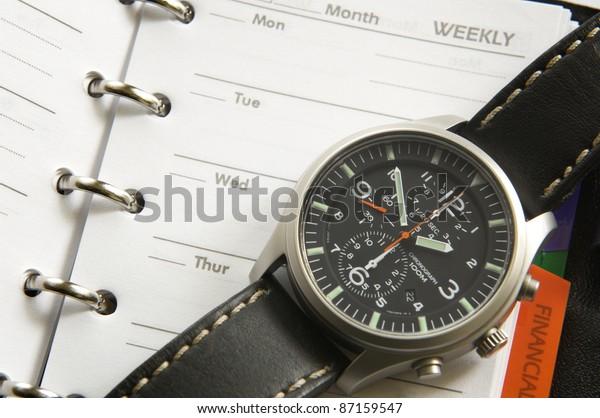 Macro photograph of an orginezer and wrist watch