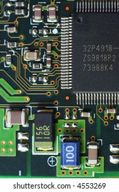 A macro photograph of a printed circuit board and components
