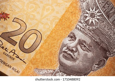 Macro photography of 20 Malaysian Ringgit. Extreme close up of RM20 Malaysia. Portrait of the first King or Agong of Malaysia. Paper currency closeup