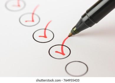 Macro photography of check mark on white background