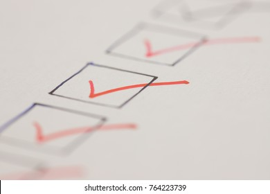 Macro photography of check mark over white background