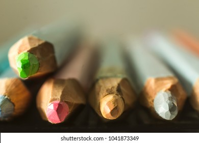Macro photography  of colored pencils. Blurred perspective. Mechanical sharpening of pencils. Photo for the site about art, hobbies, education.