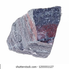 macro photography of natural mineral from geological collection - raw jaspillite ( ferruginous quartzite) stone on white background