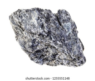 macro photography of natural mineral from geological collection - raw quartz biotite schist stone on white background