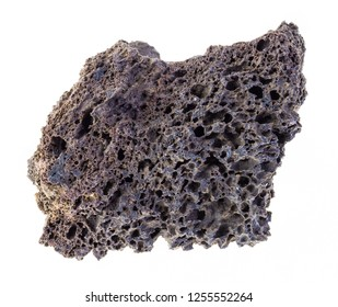 macro photography of natural mineral from geological collection - raw pumice stone on white background