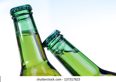macro photography of two bottles of beer on white background