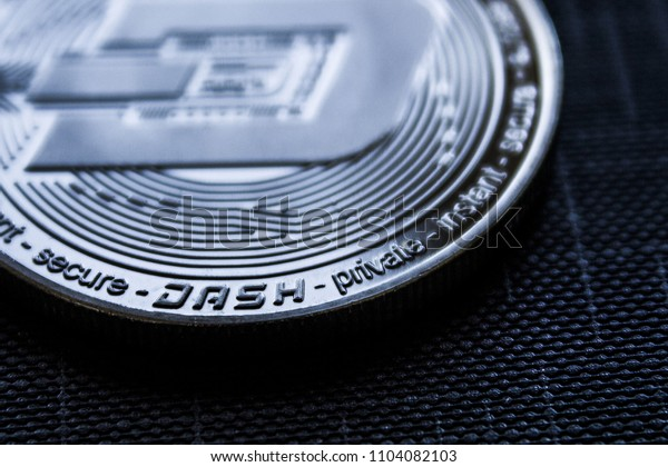 Macro physical Coin cryptocurrency Dash on black background.
