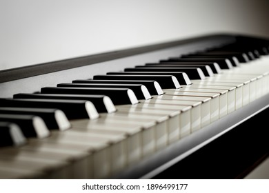 Macro of a piano keyboard with unfocused background