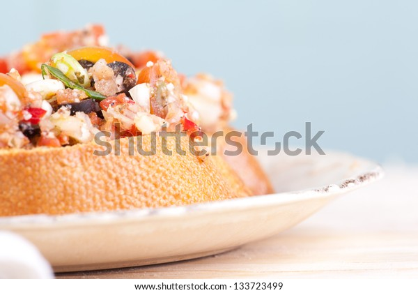macro picture of bruschetta on the plate
