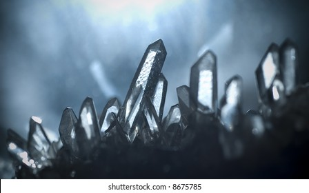 macro picture of some quartz gems shot in a cave. Natural light irradiates the crystals