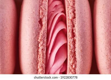 Macro plan of pink French macarons imagine as female genital organs, vagina