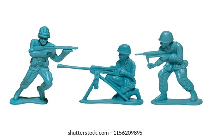 macro plastic toy soldiers with guns on white background