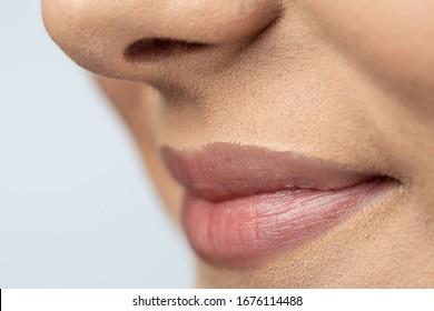 Macro pose of woman's beautiful pink lips.