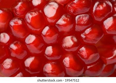 macro of ripe seeds pomegranate isolated