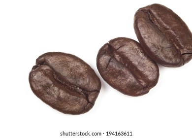 Macro roasted coffee beans isolated on white background