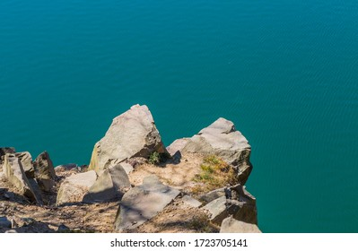 Macro of a rock in Knivasen Dalby, Skane Sweden at the lake with turquoise water.