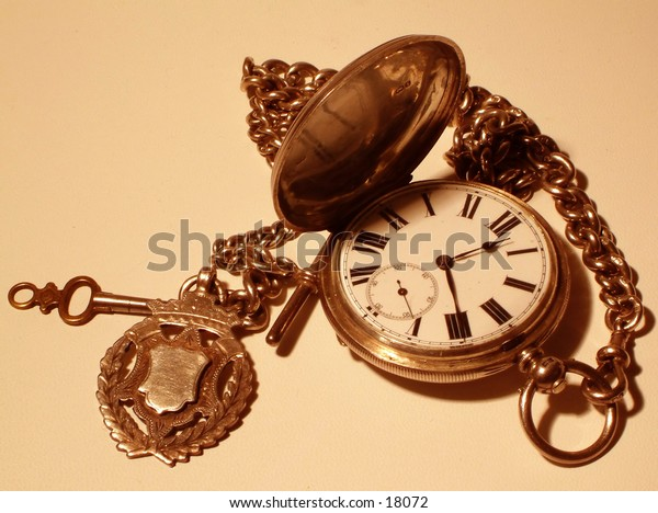 Macro sepia effect of old pocket watch and key