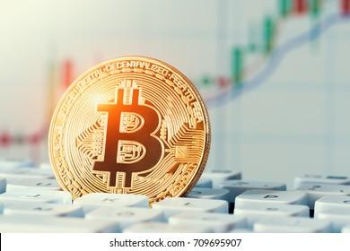 macro shiny bitcoin on computer keyboard. virtual cryptocurrency concept