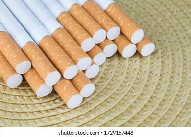 Macro shoot of cigarette filters. Heap of Tobacco Cigarettes.