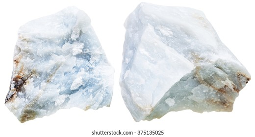 macro shooting of natural mineral stone - two pieces blue Anhydrite (Angelite) rock isolated on white background