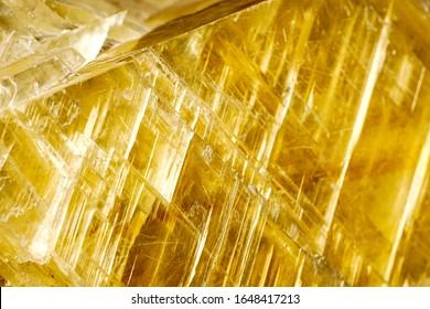 Macro shooting of natural rock specimen - raw crystal of Citrine (yellow quartz) gemstone