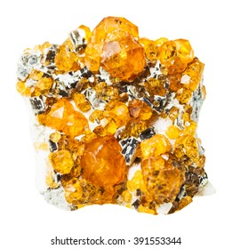 macro shooting of natural rock specimen - druse of spessartine mineral stone isolated on white background