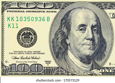 "Macro shot of a 100 dollar. Benjamin Franklin as depicted on the bill. ""This Note Is Legal Tender For All Debts, Public And Private"""