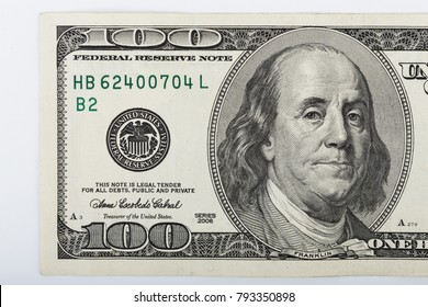 Macro shot of a 100 dollar. Dollars Closeup Concept. American Dollars Cash Money. One Hundred Dollar Banknotes. Hundred Bucks. Benjamin Franklin's portrait.