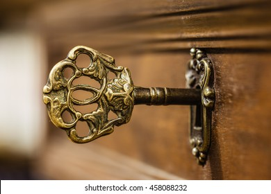 macro shot of an antique and weathered vintage key in his keyhole
