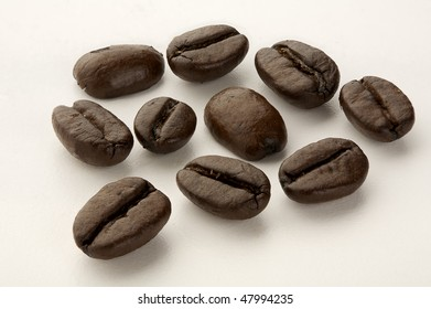 Macro shot of Arabica coffee beans isolated on white