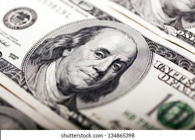 Macro shot of Benjamin Franklin's portrait on a 100 US$ money note.