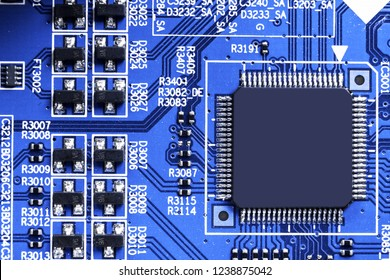 Macro shot of a Circuitboard with resistors microchips and electronic components. Computer hardware technology. Integrated communication processor. Information engineering. Semiconductor. PCB. Closeup