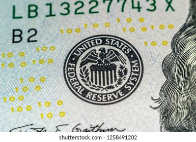 """Macro shot (closeup ) of a new 100 dollar bill Series 2009 A. Yellow """"100"""" signs and seal of federal reserve system"""