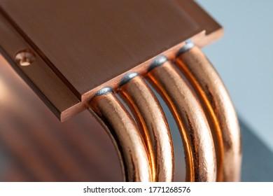 A macro shot of a copper heatsink for computer processors