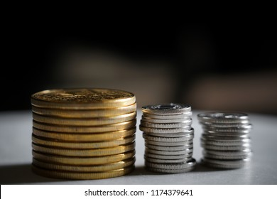 Macro shot detail of golden and silver color coin stacks on dark background with copy space for text. Business and finance growth, saving money, investment and interest concept. selective focus
