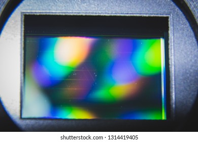 Macro shot of dirty CMOS sensor in mirrorless camera under bright light reveals debris on the sensor that needed to be clean.