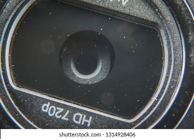 Macro shot of a dusty 720p HD desktop or laptop pc computer webcam lens. Privacy and spy concept
