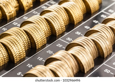 macro shot of a lot of euro coins stacked in a plastic coin organizer