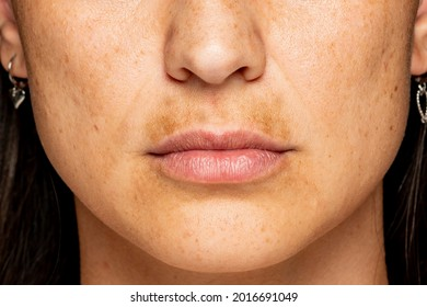 macro shot of a female face with dark skin on the upper lip