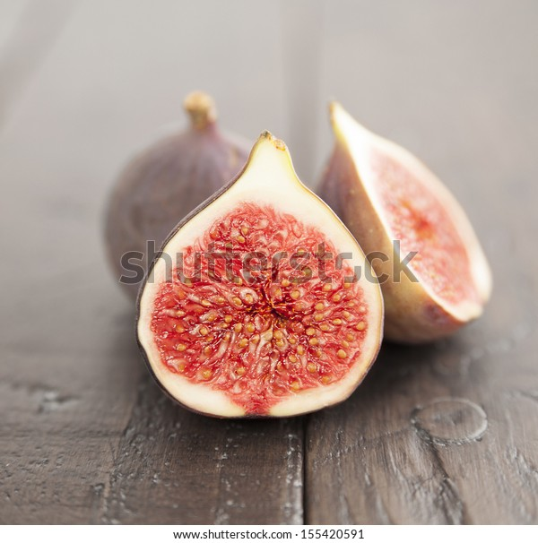 macro shot of fig on wooden table